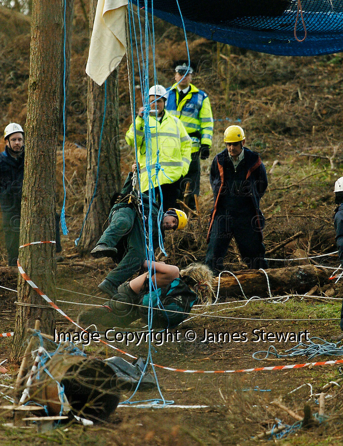 23/01/2006         Copyright Pic: James Stewart.File Name : sct_jspa17_dalkeith.MEMBERS OF THE NATIONAL EVICTION TEAM THROW A TOPLESS PROTESTER OVER THE EDGE OF HER TREE TOP CAMP AND LOWER HER TO THE GROUND AT DALKEITH PARK.......Payments to :.James Stewart Photo Agency 19 Carronlea Drive, Falkirk. FK2 8DN      Vat Reg No. 607 6932 25.Office     : +44 (0)1324 570906     .Mobile   : +44 (0)7721 416997.Fax         : +44 (0)1324 570906.E-mail  :  jim@jspa.co.uk.If you require further information then contact Jim Stewart on any of the numbers above.........