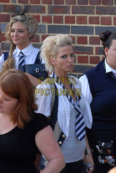 "TAMSIN EGERTON & SARAH HARDING.Filming on the set of ""St Trinian's: The Legend of Fritton's Gold"", outside the Globe Theatre, London, England..August 10th, 2009.2 half length black grey gray top white shirt scarf striped stripes girls aloud looks angry upset waistcoat beige film movie .CAP/IA .©Ian Allis/Capital Pictures."