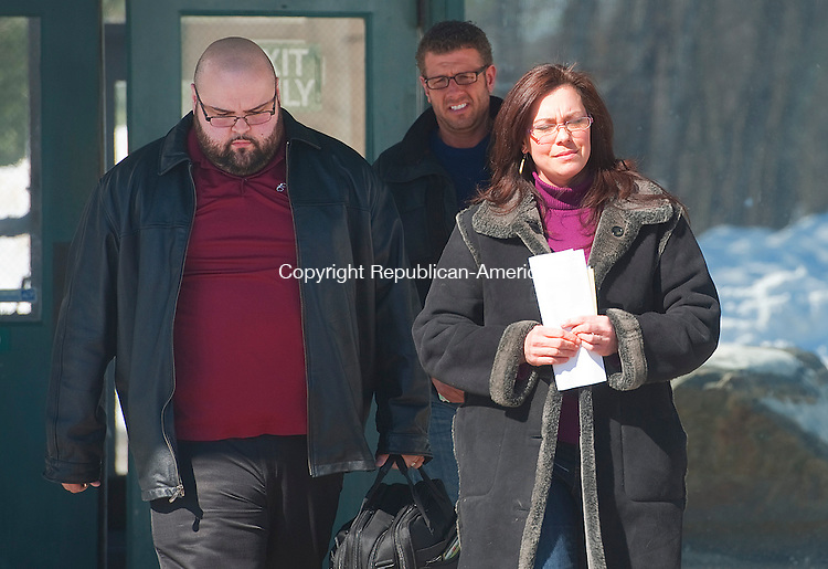 BANTAM,  CT-022715JS03- Tara Bryson, right,  co-owner of Butterfield Farm, and Michael Hearl, center, leaves Bantam Superior Court on Friday with a bail bondsman after posting bond on animal cruelty charges.   Earlier this year, state inspectors found dozens of dead and dying goats inside a barn Bryson and  Hearl, rented on Hautboy Hill Road in Cornwall.<br /> Jim Shannon Republican-American