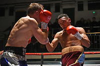 Jordan Blake (burgundy shorts) defeats Zygimantas Butkevius during a Boxing Show at York Hall on 2nd February 2019