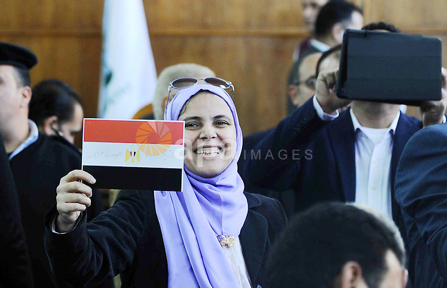 """An Egyptian woman celebrates with a national flag defaced with the words """"Tiran"""" and """"Sanafir"""" after the Supreme Administrative Court upheld on January 16, 2017 a ruling voiding a government agreement to hand over the two Red Sea islands of Tiran and Sanafir to Saudi Arabia in a deal that had sparked protests in Egypt. Photo by Amr Sayed"""