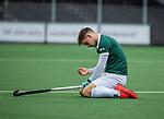 AMSTELVEEN -  Tristan Algera (R'dam) wordt geraakt ,   tijdens de hoofdklasse competitiewedstrijd heren, AMSTERDAM-ROTTERDAM (2-2). . COPYRIGHT KOEN SUYK