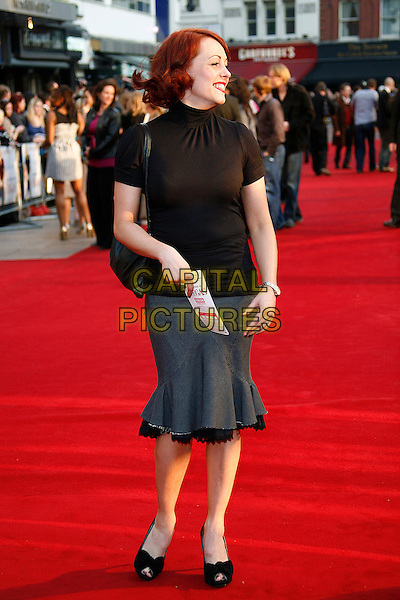 "SARAH CAWOOD .At the UK Film Premiere of ""What Happens In Vegas"" held at the Odeon Leicester Square, London, England, .April 22nd 2008..full length Sara black top grey gray skirt fishtail black shoes peep toe bows polo neck.CAP/DAR.©Darwin/Capital Pictures"