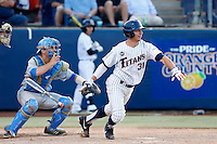 Jared Deacon #31 of the Cal State Fullerton Titans bats in front of Shane Zeile #14 of the UCLA Bruins during the NCAA Super Regional at Goodwin Field on June 7, 2013 in Fullerton, California. UCLA defeated Cal State Fullerton, 5-3. (Larry Goren/Four Seam Images)