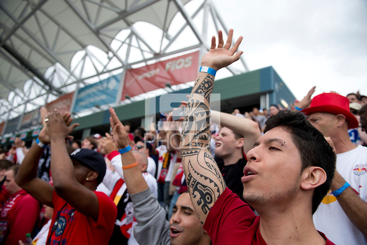 A New York fan cheers on his team before the game at PPL Park in Chester, PA.  New York defeated Philadelphia, 3-0.