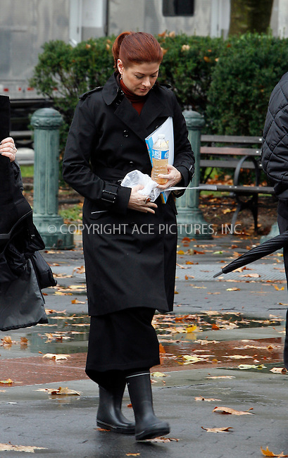 WWW.ACEPIXS.COM . . . . .  ....November 23 2011, New York City....Actress Debra Messing wears wellington boots on the set of the TV show 'Smash' on November 23 2011 in New York City....Please byline: CURTIS MEANS - ACE PICTURES.... *** ***..Ace Pictures, Inc:  ..Philip Vaughan (212) 243-8787 or (646) 679 0430..e-mail: info@acepixs.com..web: http://www.acepixs.com
