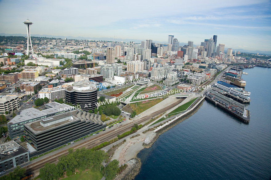 Aerial view looking south along the Seattle waterfront with the Seattle Art Museum's Olympic Sculpture Park in the center, the Space Needle at left, and the skyscrapers of downtown back right.