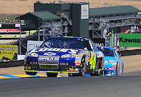 Jun. 21, 2009; Sonoma, CA, USA; NASCAR Sprint Cup Series driver Jimmie Johnson during the SaveMart 350 at Infineon Raceway. Mandatory Credit: Mark J. Rebilas-