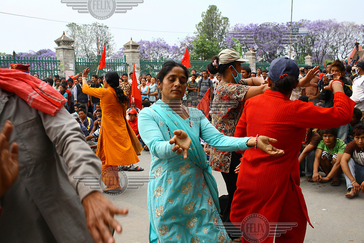 Women dance as they protest at a strike called by the Unified Communist Party of Nepal (UCPN) to remove the ruling government. The Maoist opposition blocked streets leading to key government offices on the 6th May, the fifth day of their crippling general strike to demand the prime minister's resignation, but the government has vowed not to bow to the protesters' pressure. The Maoists, known to use violence to back their strike calls, have demanded that residents halt all travel and keep businesses and schools closed since Sunday in their campaign to get Prime Minister Madhav Kumar Nepal to resign and hand power to a Maoist-led government. The strike has shut down most businesses, schools and transport, with daily activity grinding to a standstill.
