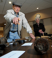 NWA Media/ J.T. Wampler -Harry Christen points out favorites items in his collection Wednesday Dec. 31, 2014 at the Shiloh Museum in Springdale.