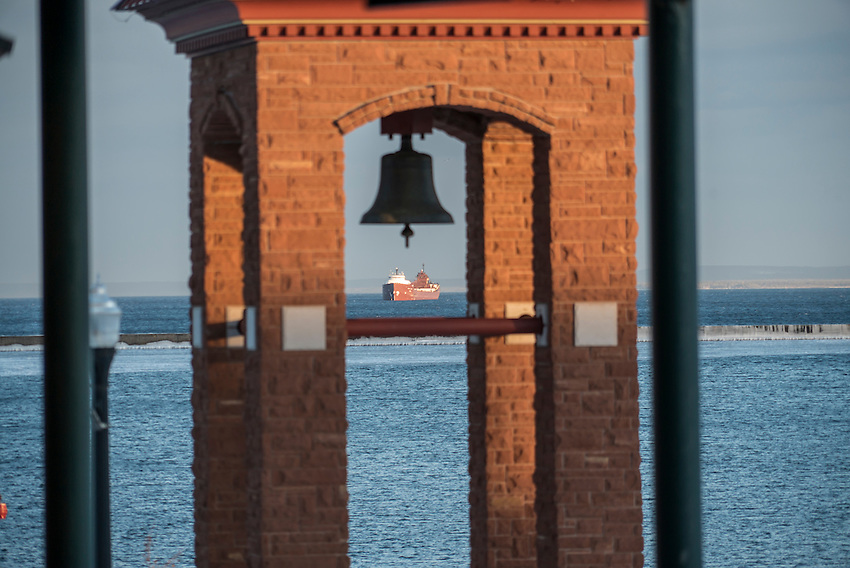 A freighter waits out a winter storm in Marquette Harbor as seen from the downtown of Marquette, Michigan.