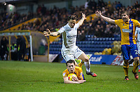 Jack Thomas of Mansfield Town holds onto the ball under pressure from Sam Saunders of Wycombe Wanderers during the The Checkatrade Trophy  Quarter Final match between Mansfield Town and Wycombe Wanderers at the One Call Stadium, Mansfield, England on 24 January 2017. Photo by Andy Rowland.