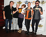 HOLLYWOOD, FL - OCTOBER 11: Chris Allen, Elaine Bradley, Tyler Glenn, Branden Campbell of Alternative rock band Neon Trees and manager of Hard Rock Cafe of Hollywood Scott Jacobs (L) donate sign bass guitar memorabilia  to Hard Rock Hotel at Hard Rock Cafe! in the Seminole Hard Rock Hotel & Casino on October 11, 2011 in Hollywood, Florida. (Photo by Johnny Louis/jlnphotography.com)