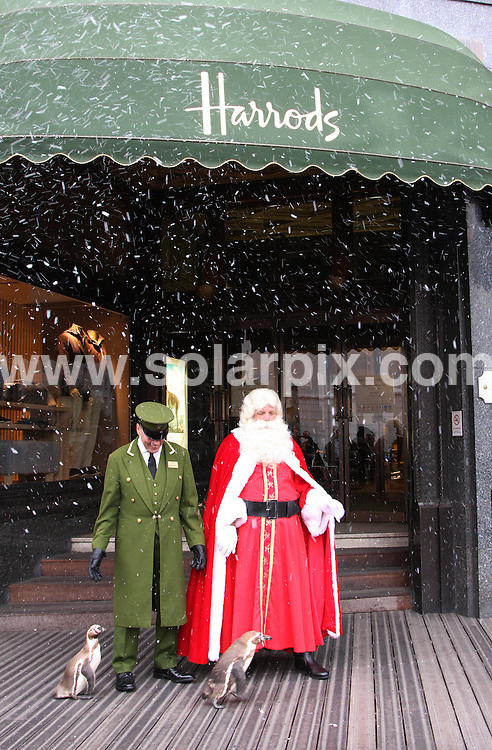 **ALL ROUND PICTURES FROM SOLARPIX.COM**.**WORLDWIDE SYNDICATION RIGHTS**.Father Christmas, aka Santa Claus, is joined by real penguins Percy and Polly to unveil the departments store's festive season. The 10,000 square foot department offers gifts, decorations, crackers and snow globes at The Harrods Store in Brompton Road, Knightsbridge, London, UK. 4 August 2009..This pic: Father Christmas, aka Santa Claus..JOB REF: 9681 LNJ     DATE: 04_08_2009.**MUST CREDIT SOLARPIX.COM OR DOUBLE FEE WILL BE CHARGED**.**MUST NOTIFY SOLARPIX OF ONLINE USAGE**.**CALL US ON: +34 952 811 768 or LOW RATE FROM UK 0844 617 7637**