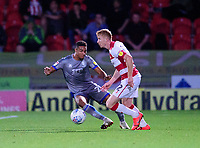 Lincoln City's Max Melbourne vies for possession with Doncaster Rovers' Brad Halliday<br /> <br /> Photographer Andrew Vaughan/CameraSport<br /> <br /> EFL Leasing.com Trophy - Northern Section - Group H - Doncaster Rovers v Lincoln City - Tuesday 3rd September 2019 - Keepmoat Stadium - Doncaster<br />  <br /> World Copyright © 2018 CameraSport. All rights reserved. 43 Linden Ave. Countesthorpe. Leicester. England. LE8 5PG - Tel: +44 (0) 116 277 4147 - admin@camerasport.com - www.camerasport.com