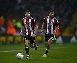 Cameron Carter-Vickers of Sheffield Utd creates an overlap for George Baldock of Sheffield Utd during the Championship match at the Bramall Lane Stadium, Sheffield. Picture date 27th September 2017. Picture credit should read: Simon Bellis/Sportimage
