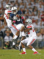 Ohio State Buckeyes linebacker Darron Lee (43) and Ohio State Buckeyes cornerback Armani Reeves (26) break up a pass meant for Penn State Nittany Lions wide receiver DaeSean Hamilton (5) in the second half at Beaver Stadium on October 25, 2014.  (Chris Russell/Dispatch Photo)