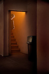 Motel staircase with ghost in staircase.