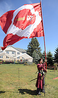 PSHRINE07P<br /> Re-enactor Steve DiFiore of Easton, Pennsylvania places a Polish battle flag in place during the 50th annual Polish American family festival and country fair at the National Shrine of Our Lady of Czestochowa Sunday September 6, 2015 in Doylestown, Pennsylvania.  (William Thomas Cain/For The Inquirer)