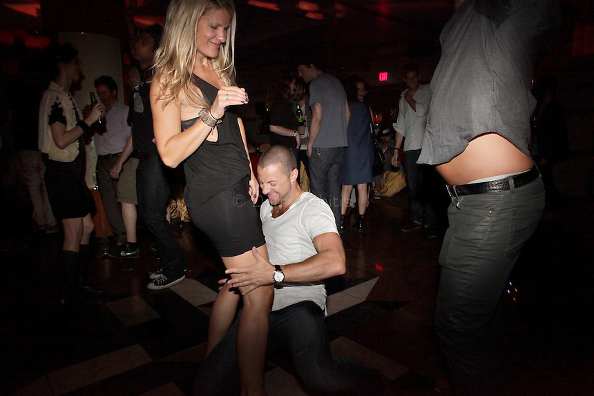 Club-goers dance the night away at Madam Wong night club.  By day Golden Unicorn is a traditional Chinese restaurant, but it is transformed into Madam Wong, a trendy Manhattan club at night. ..Danny Ghitis for The New York Times