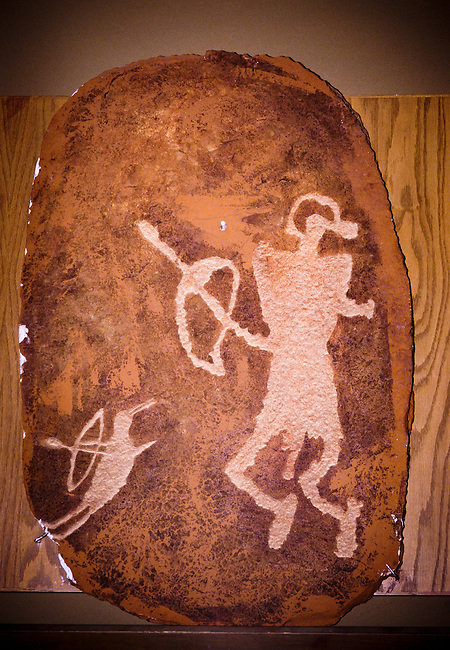 Ute petroglyph rock carving of two warriors or hunters with bow and arrow symbols, Vernal, Utah