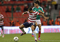 MEXICO CITY, MEXICO - AUGUST 15, 2012:  Jermaine Jones (13) of the USA MNT blocks the ball from Edgar Lugo (23) of  Mexico during an international friendly match at Azteca Stadium, in Mexico City, Mexico on August 15. USA won 1-0.