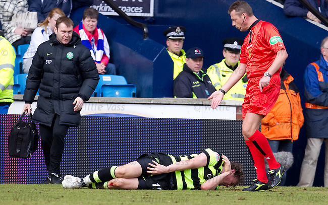 Morten Rasmussen in agony after a stamping from Tim Clancy as referee Iain Brines looks at his knee
