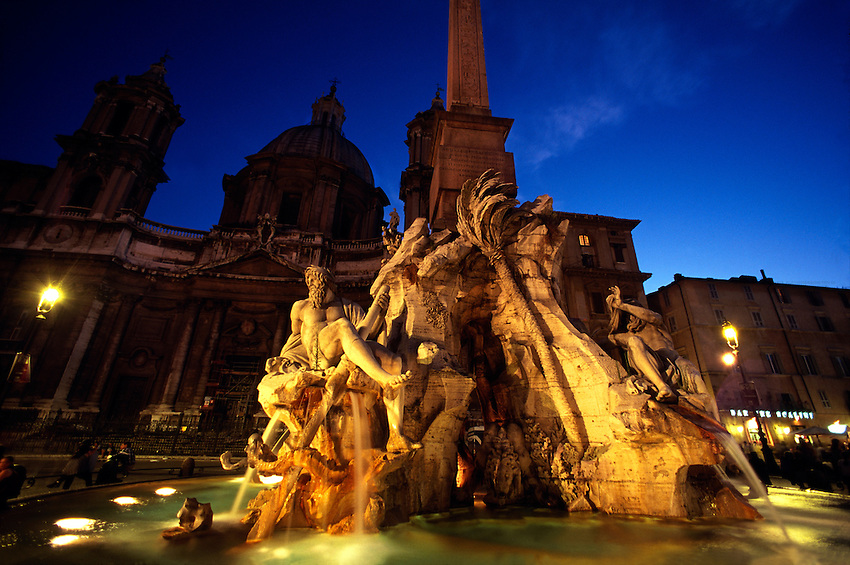 Fountain of the Four Rivers (Fontana delle Quattro Fiume) with Sant'Agnese in Agone Church behind, Piazza Navona, Rome, Italy