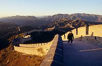 Lone man walking along the Great Wall near Badaling at sunrise.