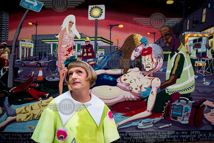Grayson Perry photographed in front of his works, Lamentation, 2012, at the Royal Academy's Summer Show on Piccadilly in central London.