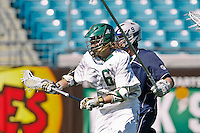 February 20, 2011:  Jacksonville Dolphins midfielder Robert Moore (6) during Lacrosse action between the Georgetown Hoyas and Jacksonville Dolphins during the Moe's Southwest SunShine Classic played at EverBank Field in Jacksonville, Florida.  Georgetown defeated Jacksonville 14-11.