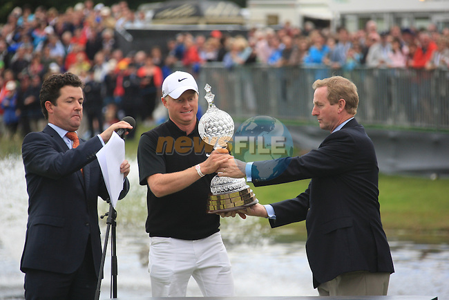 Simon Dyson (ENG) and An Taoiseach Enda Kenny presenting Simon with the Waterford Crystal trophy after the Final Day Sunday round of The Irish Open presented by Discover Ireland at Killarney Golf & Fishing Club on 31st July 2011 (Photo Fran Caffrey/www.golffile.ie)