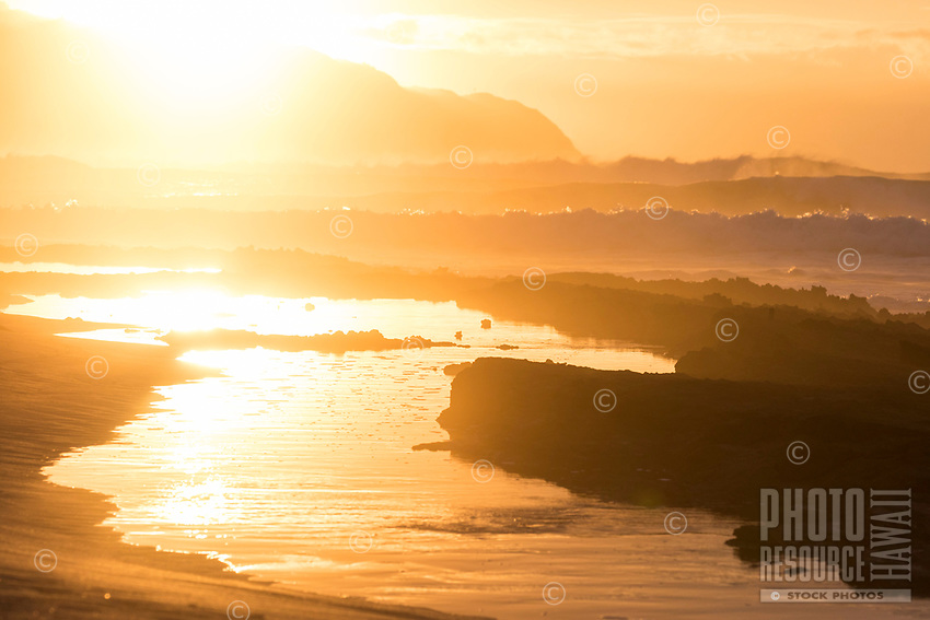 Sunset over big waves at Pua'ena Point, Hale'iwa, North Shore, O'ahu.