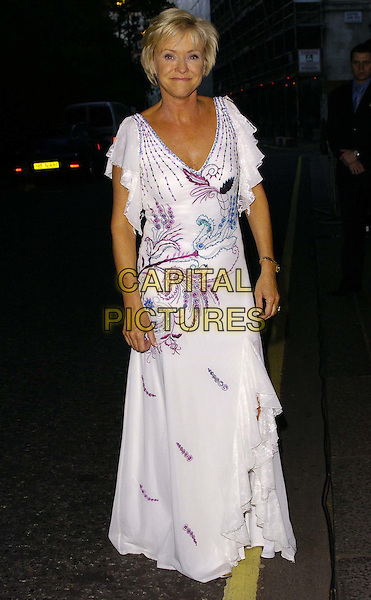 SUE BARKER.At the Wimbledon Champions Dinner, The Savoy Hotel, London, England, July 9th 2006..full length white dress purple beads beaded.Ref: CAN.www.capitalpictures.com.sales@capitalpictures.com.©Can Nguyen/Capital Pictures