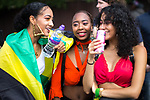 © Joel Goodman - 07973 332324 . 12/08/2017 . Manchester , UK . People gather along the route to watch the parade . The annual Caribbean Carnival J'Ouvert Parade through Moss Side in South Manchester . The 2017 theme is Bacchanal . There is concern in the community following the stabbing to death of Sait Mboob during a mass fight which saw several seriously hurt on Tuesday night (8th August 2017) . Photo credit : Joel Goodman