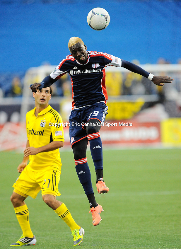 June 16 2012  New England Revolution midfielder Clyde Simms (19) heads the ball in front of Columbus Crew forward Aaron Horton (27)  during the New England Revolution vs Columbus Crew game held at Gillette Stadium, in  Foxborough, Massachusetts. Eric Canha/CSM