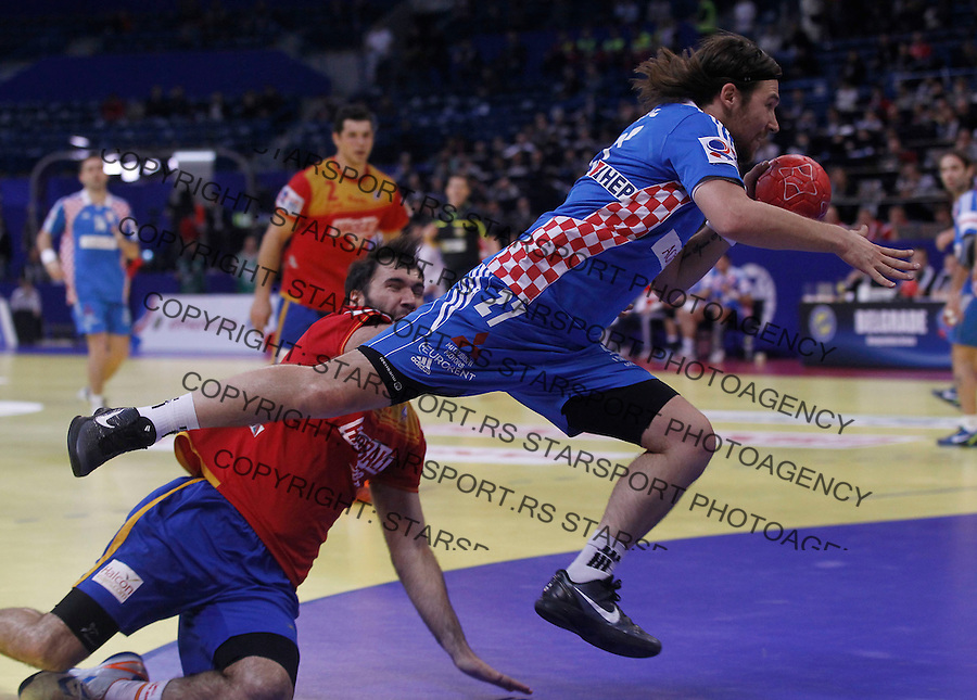 BELGRADE, SERBIA - JANUARY 29: Ivan Cupic (R) of Croatia jumps to shoot during the Men's European Handball Championship 2012 Bronze medal match between Croatia and Spain at Arena Hall on January 29, 2012 in Belgrade, Serbia. (Photo by Srdjan Stevanovic/Starsportphoto.com ©)