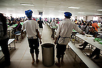 July 15, 2009 - Phnom Penh, Cambodia. Lunch is served for garment factory workers. © Nicolas Axelrod / Ruom