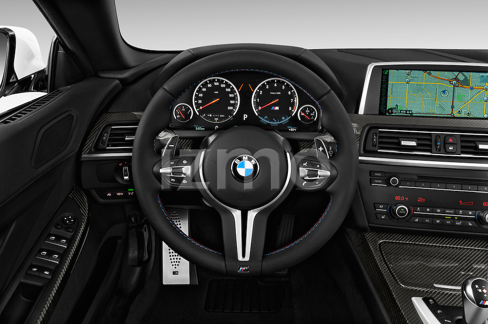 Car pictures of steering wheel view of a 2016 BMW M6 Convertible - 2 Door Convertible Steering Wheel
