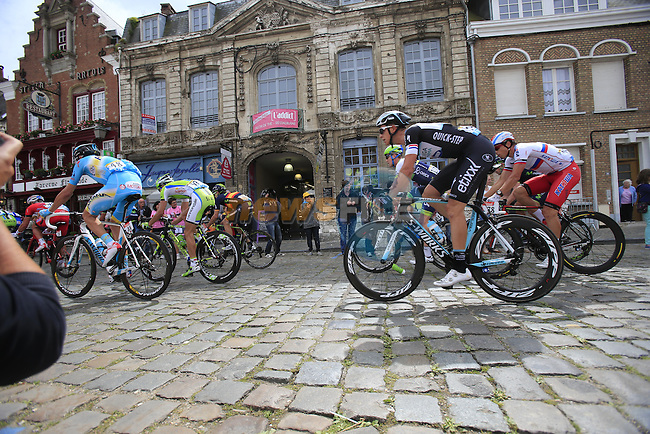 The peleton including Niki Terpstra (NED) Omega Pharma-Quick Step pass through the ancient town of Cassel during Stage 4 of the 2014 Tour de France running 163.5km from Le Touquet to Lille. 8th July 2014.<br /> Picture: Eoin Clarke www.newsfile.ie
