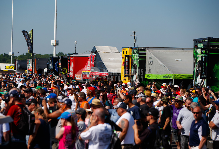 Jun 11, 2017; Englishtown , NJ, USA; Fans in the NHRA pro pits as cars warm up during the Summernationals at Old Bridge Township Raceway Park. Mandatory Credit: Mark J. Rebilas-USA TODAY Sports