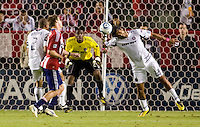 Chicago Fire defender Wilman Conde clears a ball in front of teammate goalkeeper Sean Johnson. The Chicago Fire defeated CD Chivas USA 3-1 at Home Depot Center stadium in Carson, California on Saturday October 23, 2010.