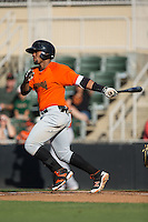 Miguel Gomez (9) of the Augusta GreenJackets follows through on his swing against the Kannapolis Intimidators at Intimidators Stadium on May 30, 2016 in Kannapolis, North Carolina.  The GreenJackets defeated the Intimidators 5-3.  (Brian Westerholt/Four Seam Images)