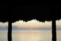 View towards Carribean Sea from thatched beach hut, Placencia, Belize