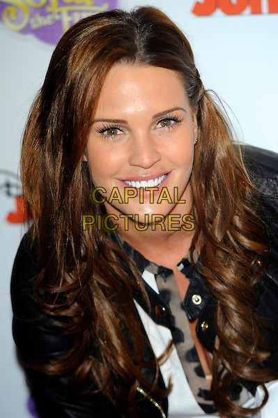 Danielle Lloyd.The launch of the Disney TV Series 'Sofia The First' at the Mayfair Hotel, London, England..22nd February 2013.headshot portrait black leather jacket white shirt leopard print trim eyelashes make-up beauty.CAP/CJ.©Chris Joseph/Capital Pictures.