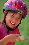 portrait of smiling young girl in helmet