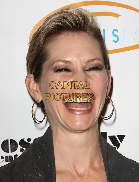 "MEREDITH MONROE. Lupus LA Raises Awareness with ""Get Lucky for Lupus"" held At Andaz Hotel, West Hollywood, California, USA..February 25th, 2010.headshot portrait gold hoop earrings mouth open smiling laughing .CAP/ADM/KB.©Kevan Brooks/AdMedia/Capital Pictures."