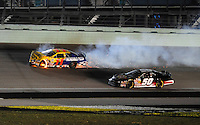 Nov. 15, 2008; Homestead, FL, USA; NASCAR Nationwide Series driver Jeremy Clements (50) goes low to avoid the smoking car of Scott Lagasse Jr (11) during the Ford 300 at Homestead Miami Speedway. Mandatory Credit: Mark J. Rebilas-