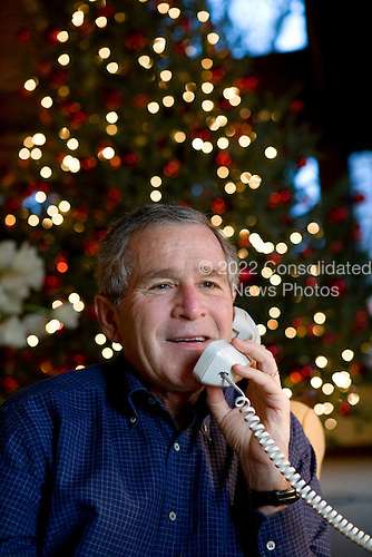 Camp David, MD - December 24, 2006 -- United States President George W. Bush makes Christmas Eve telephone calls to members of the Armed Forces at Camp David, Sunday, December 24, 2006. .Credit: Eric Draper-White House via CNP.