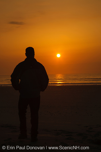 Silhouette of a man at Hampton Beach, New Hampshire at sunrise
